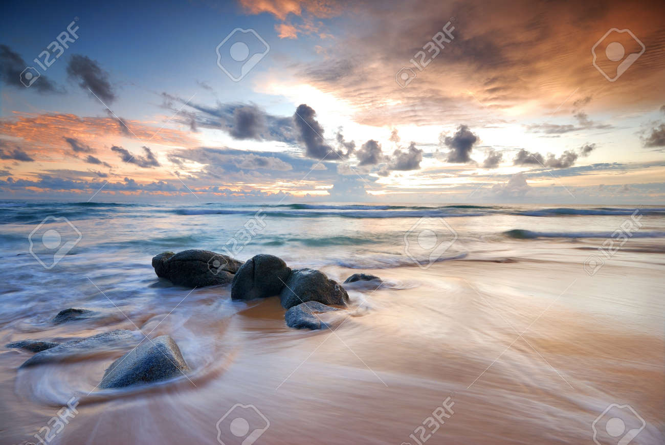 Sea waves lash line impact rock on the beach Stock Photo - 14923930