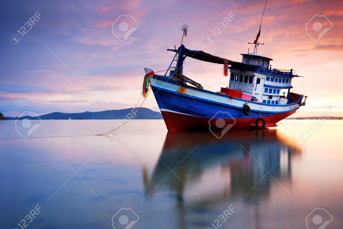 Thai fishing boat used as a vehicle for finding fish in the sea.at sunset Stock Photo - 14924241