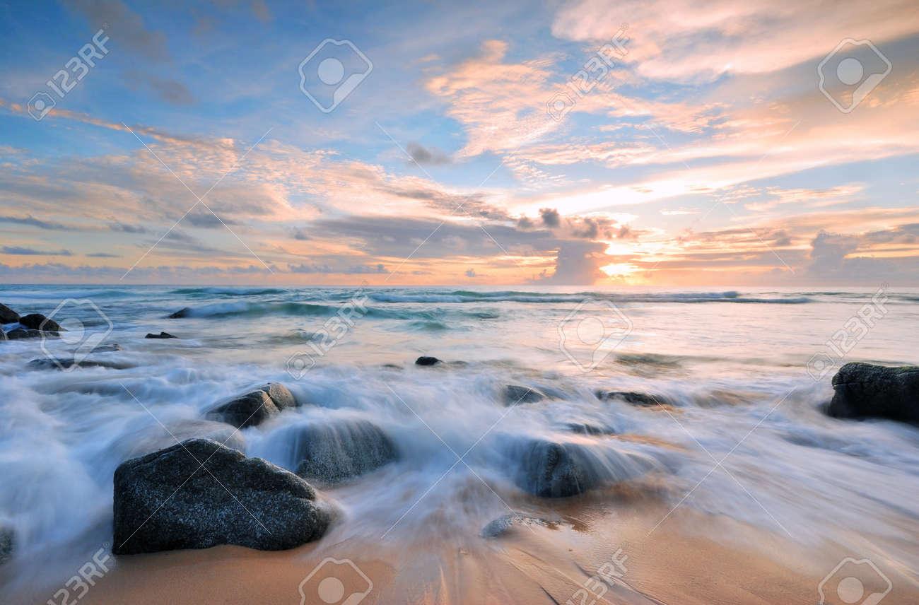 Sea waves lash line impact rock on the beach Stock Photo - 15041985