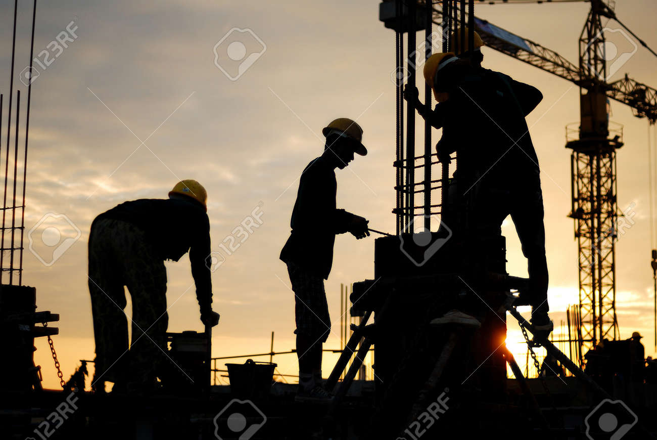 silhouette of constructionworker on constructionsite Stock Photo - 17954545