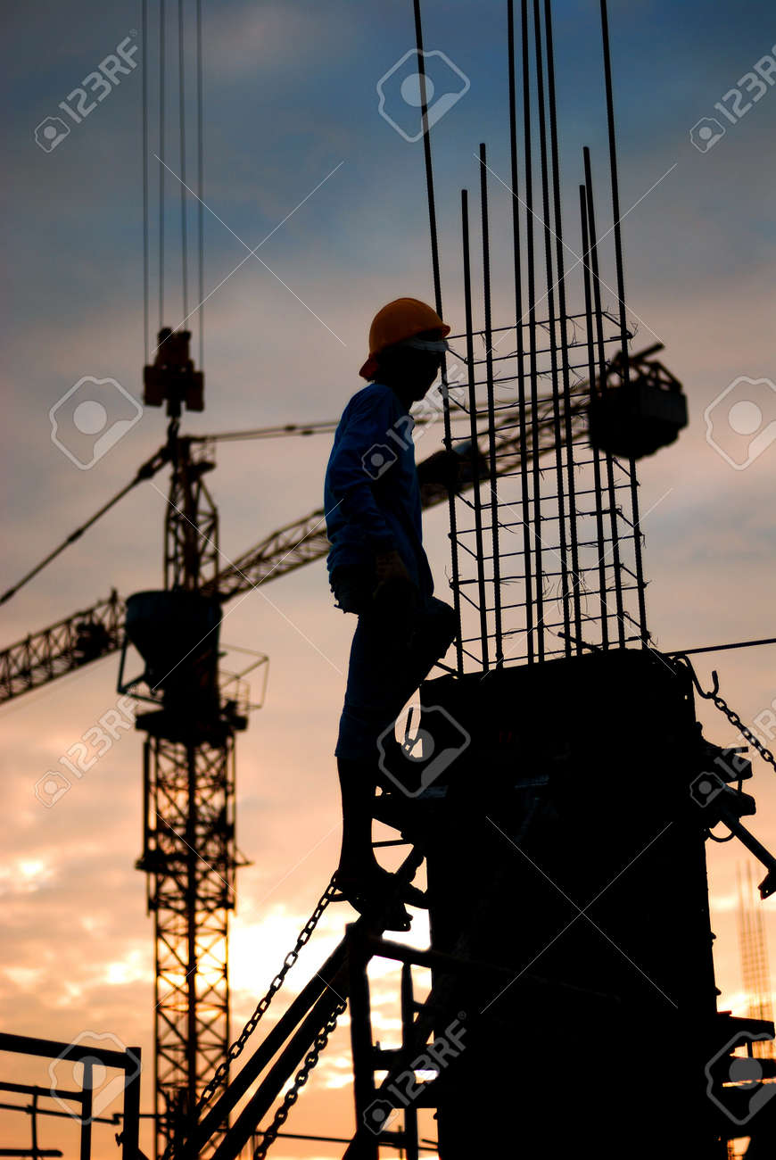 silhouette of constructionworker on constructionsite Stock Photo - 17954558