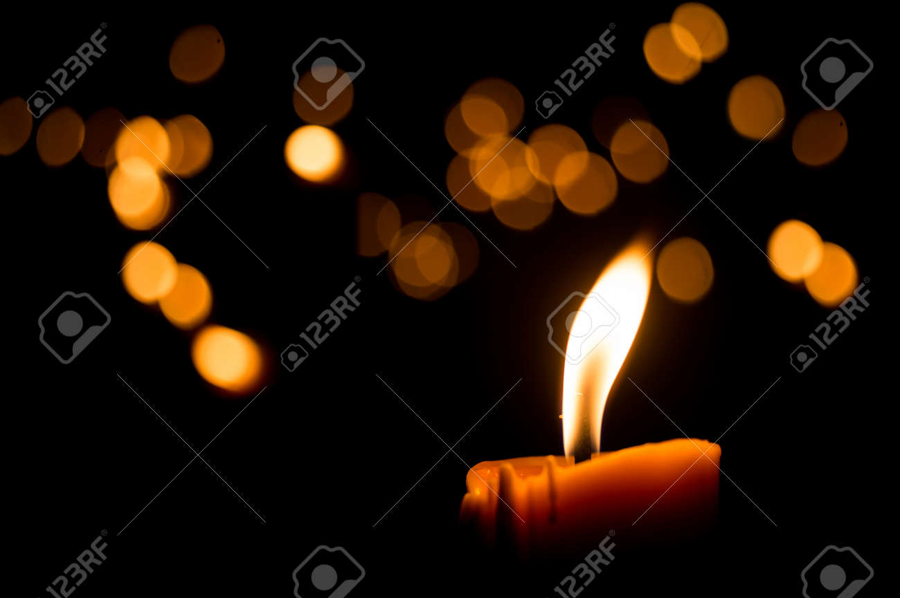 One candle flame light at night with bokeh on dark background Stock Photo - 43739262