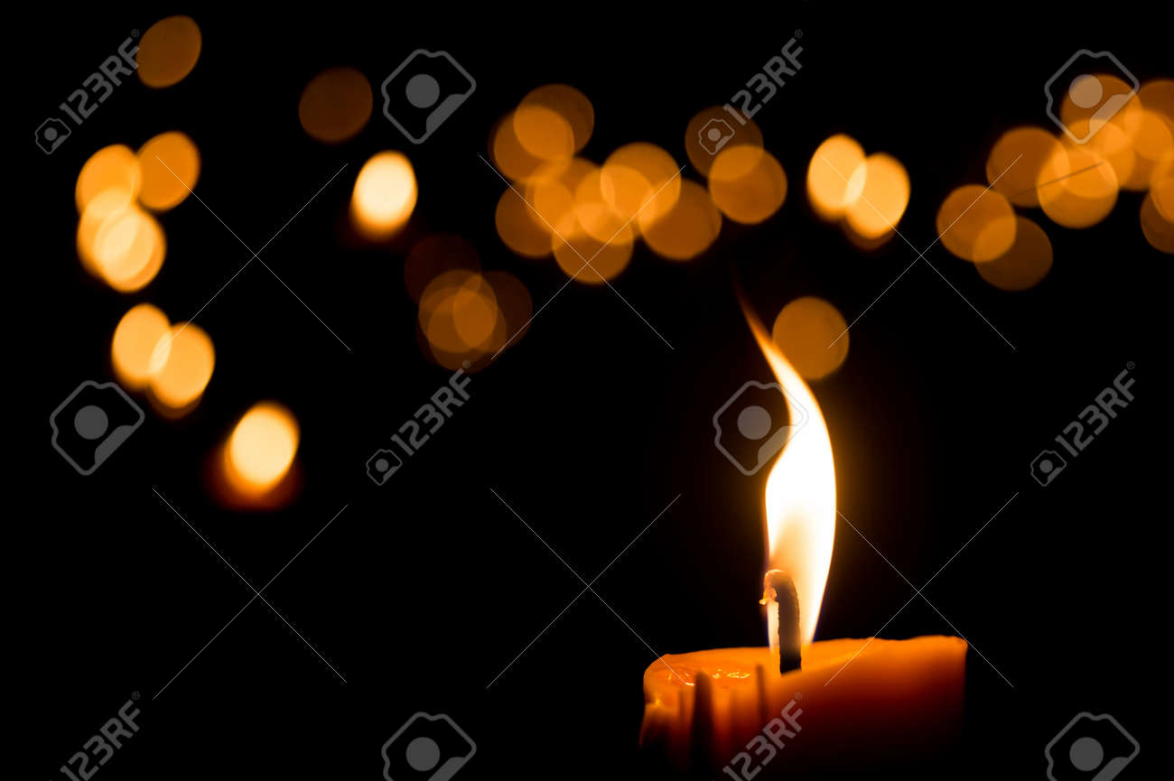 One candle flame light at night with bokeh on dark background - 44338161