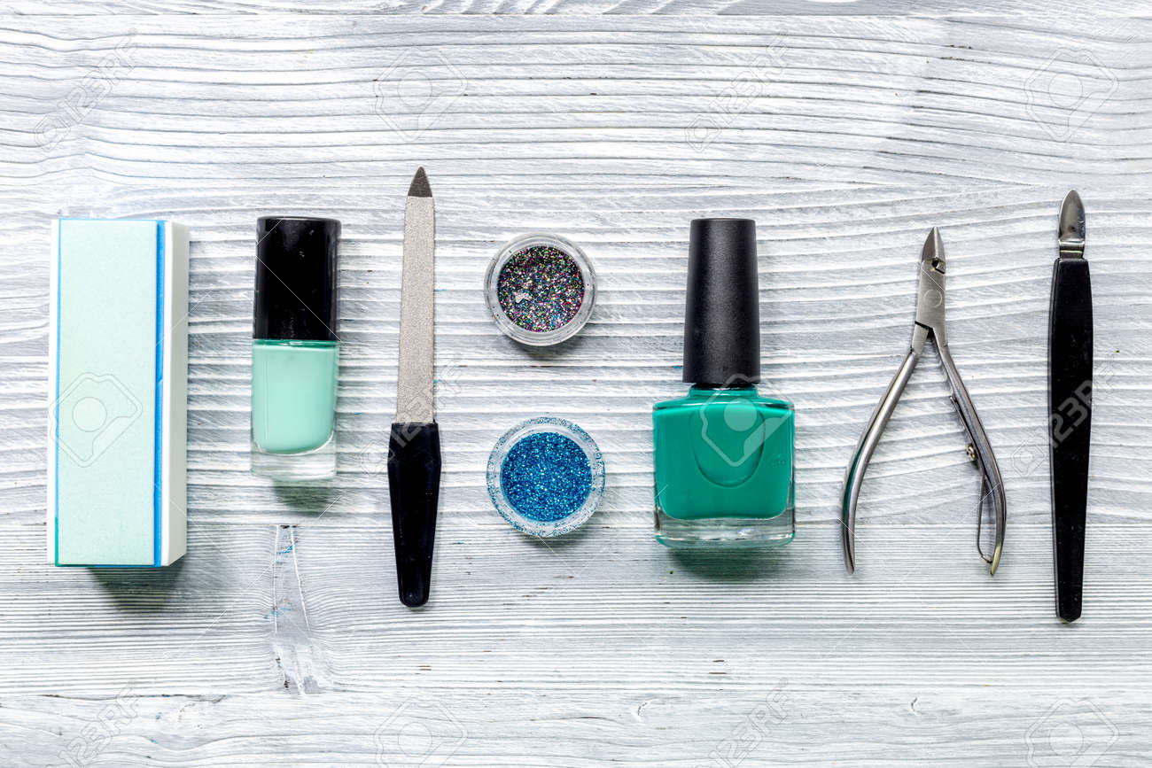 Manicure Preparation Set With Nail Polish Bottles On Gray Table ...