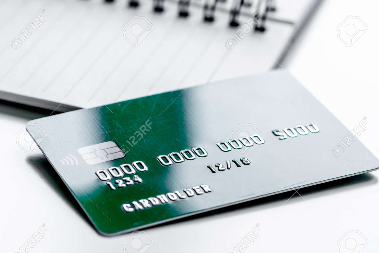 Work place with business credit cards on notebook for payment work place with business credit cards on notebook for payment on white office desk background close colourmoves