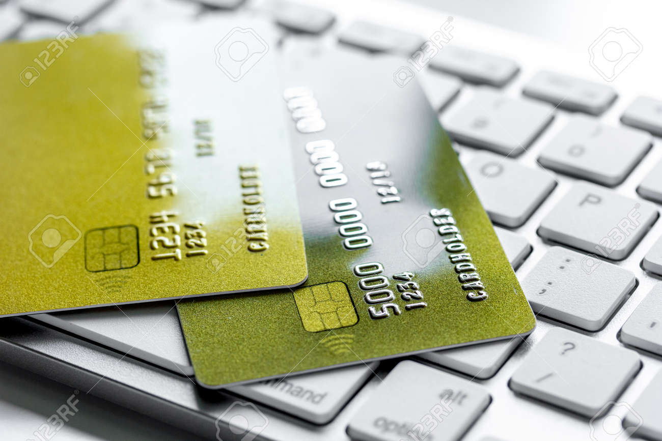Payment composition with business credit cards on keyboard at payment composition with business credit cards on keyboard at office work place white background close up colourmoves