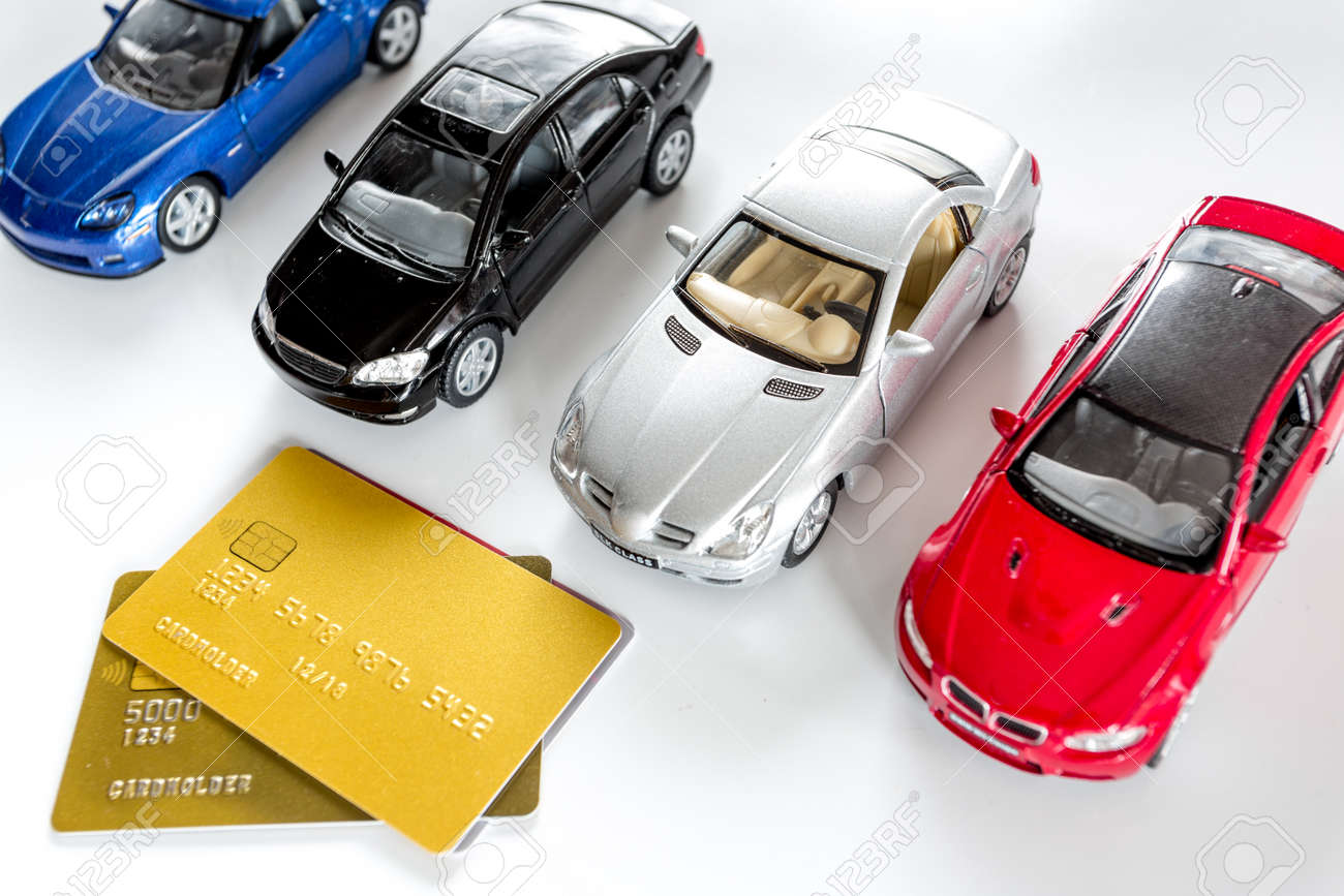 Choosing Car Concept Toy Cars And Bank Card On White Background