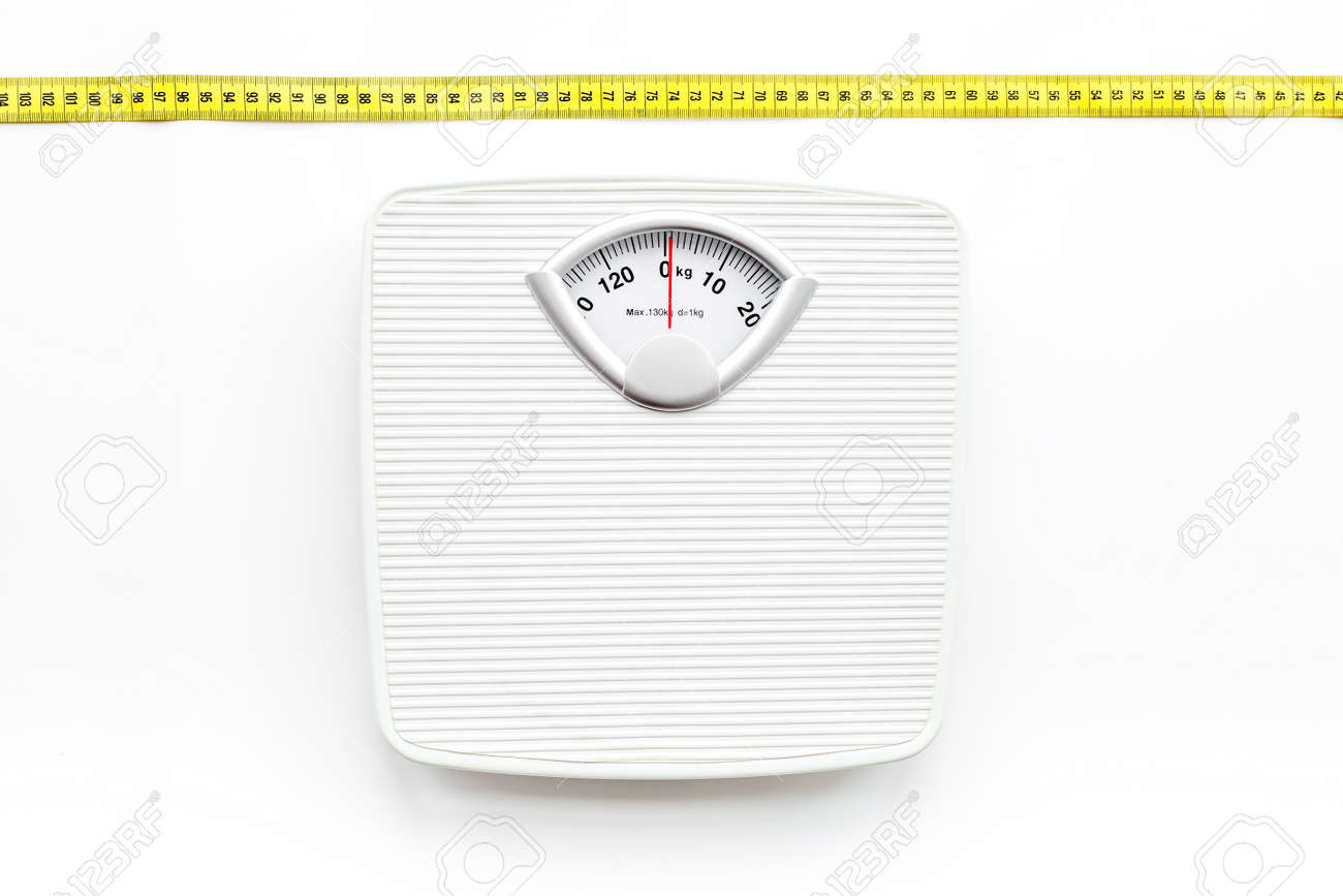 Bathroom scale and measuring tape on white background top view - 83853373