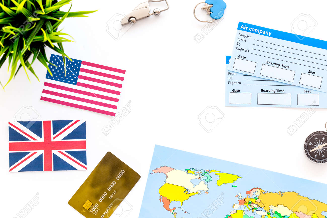 Booking trip with world map tickets flags and tourist outfit booking trip with world map tickets flags and tourist outfit on white office desk gumiabroncs Gallery