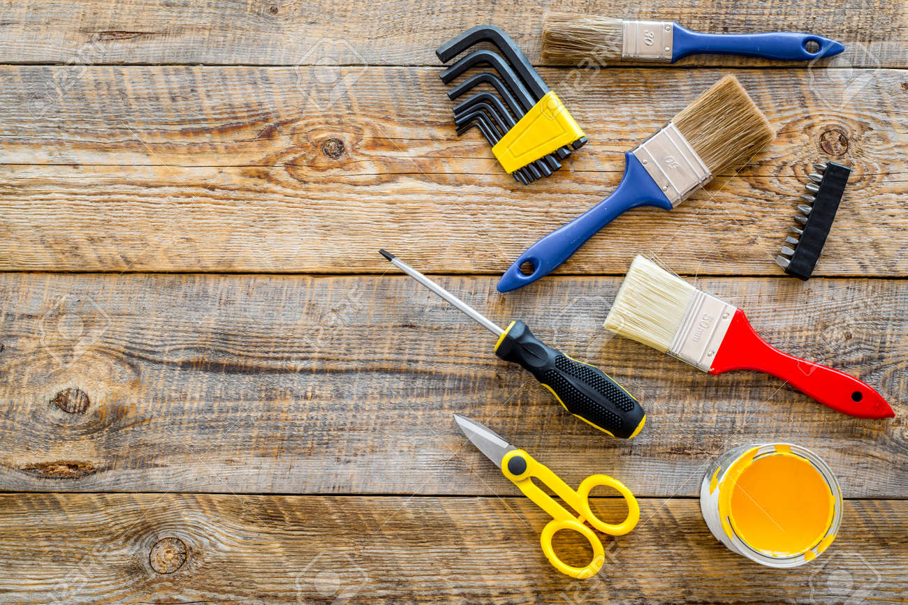 House Renovation With Implements Set For Building, Painting And Repair  Wooden Table Background Top View