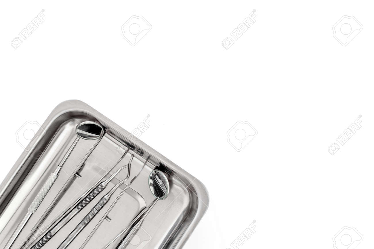 basic dentists tools in cuvette on white background top view stock