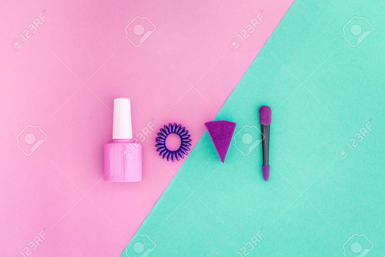 Cosmetics On Colorful Background. Pink Nail Polish And Violet ...