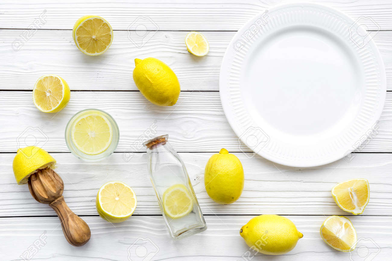 Make Lemonade At Home. Lemons, Juicer, Glass And Bottle For Beverage ...