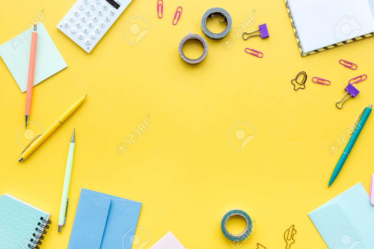 https://previews.123rf.com/images/9dreamstudio/9dreamstudio1802/9dreamstudio180200401/94878278-scattered-stationery-on-student-s-desk-yellow-background-top-view-.jpg
