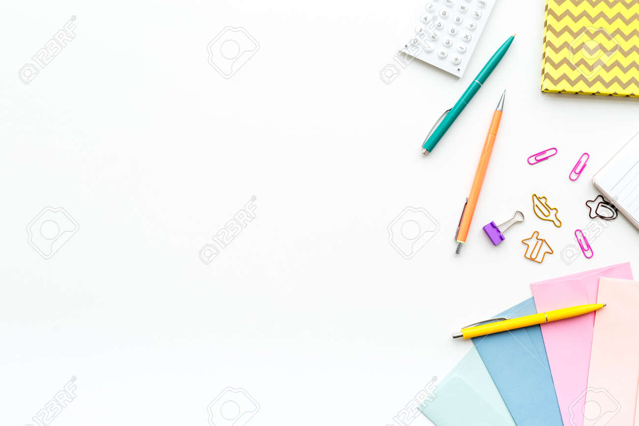 Scattered stationery on student's desk. White background top view. - 94963689