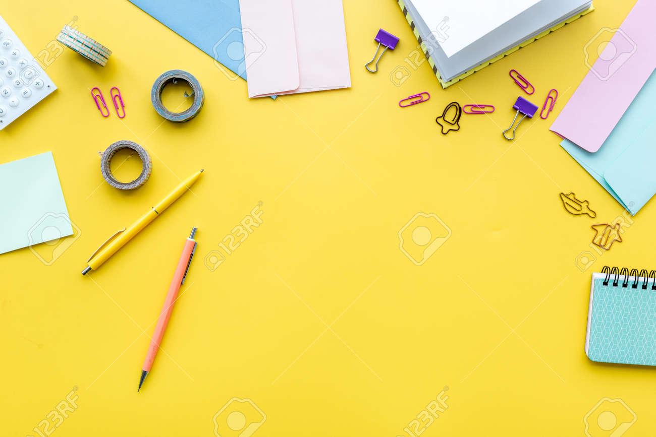 https://previews.123rf.com/images/9dreamstudio/9dreamstudio1802/9dreamstudio180200859/95030728-scattered-stationery-on-student-s-desk-yellow-background-top-view-.jpg