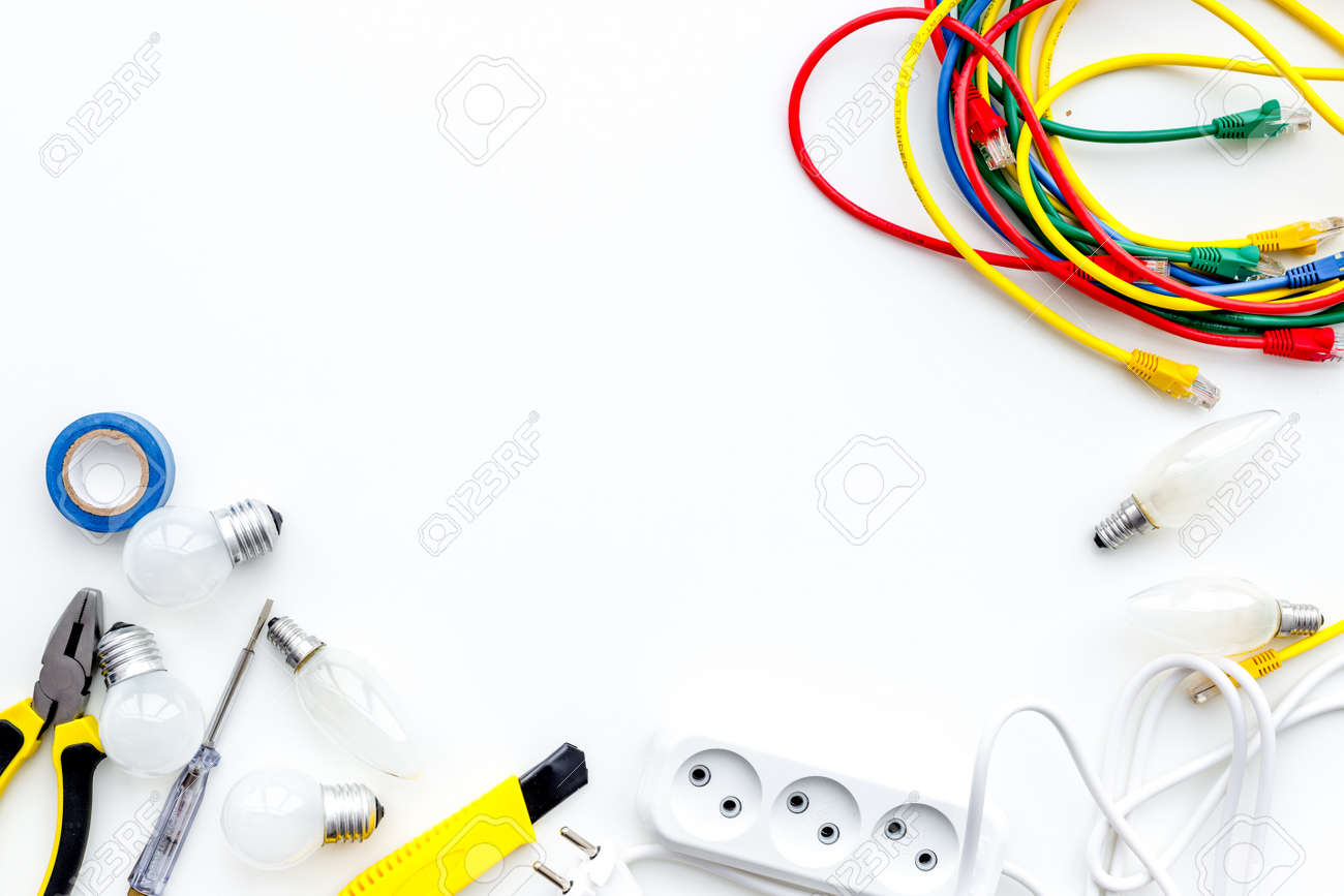 Electrical installation, wiring works. Tools, cabel and socket outlet on  white background top