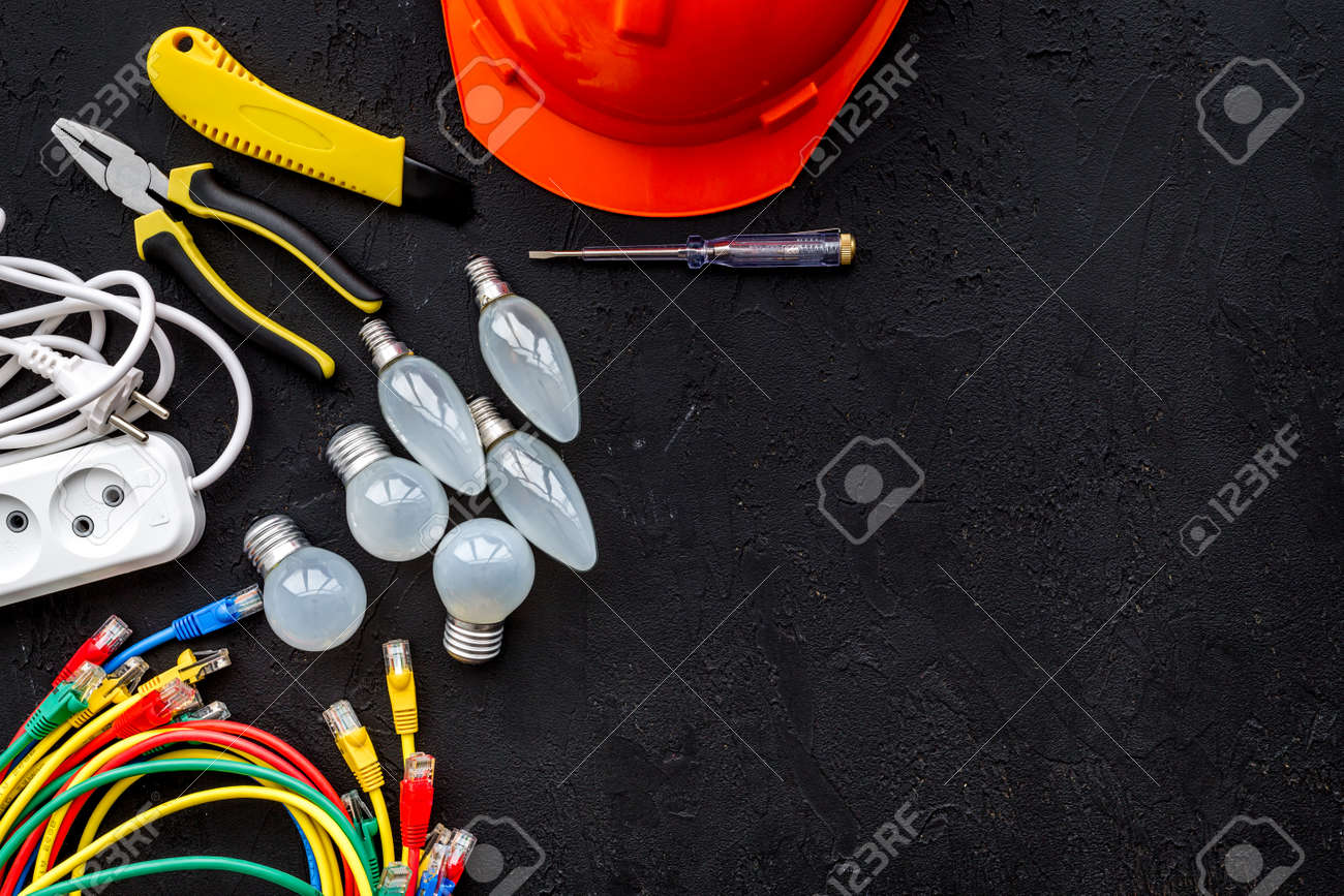 Electrician work concept  Hard hat, tools, cabel, bulb, socket