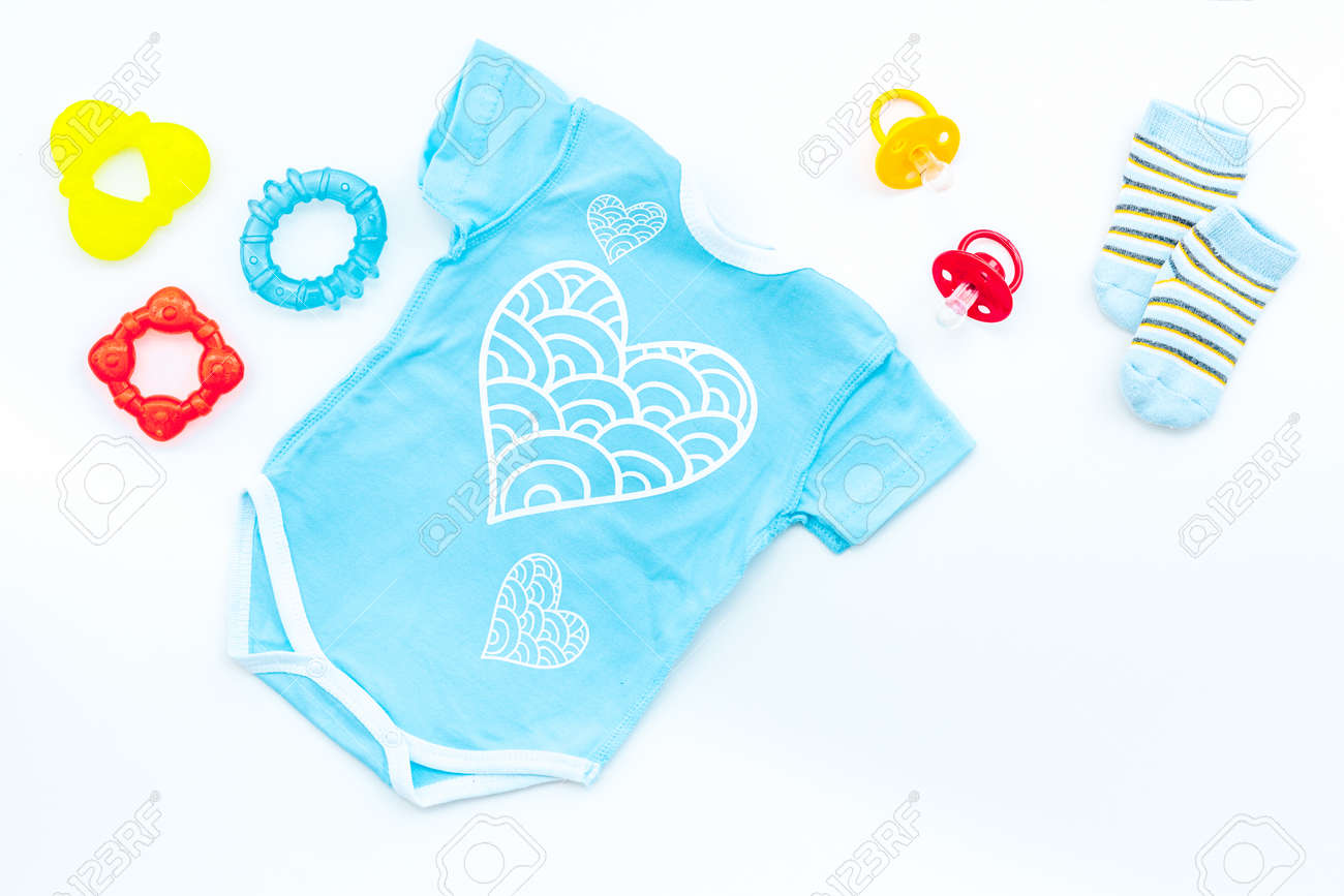 Baby Shower Concept. Babyu0027s Clothes And Accessories On White Background Top  View. Stock Photo