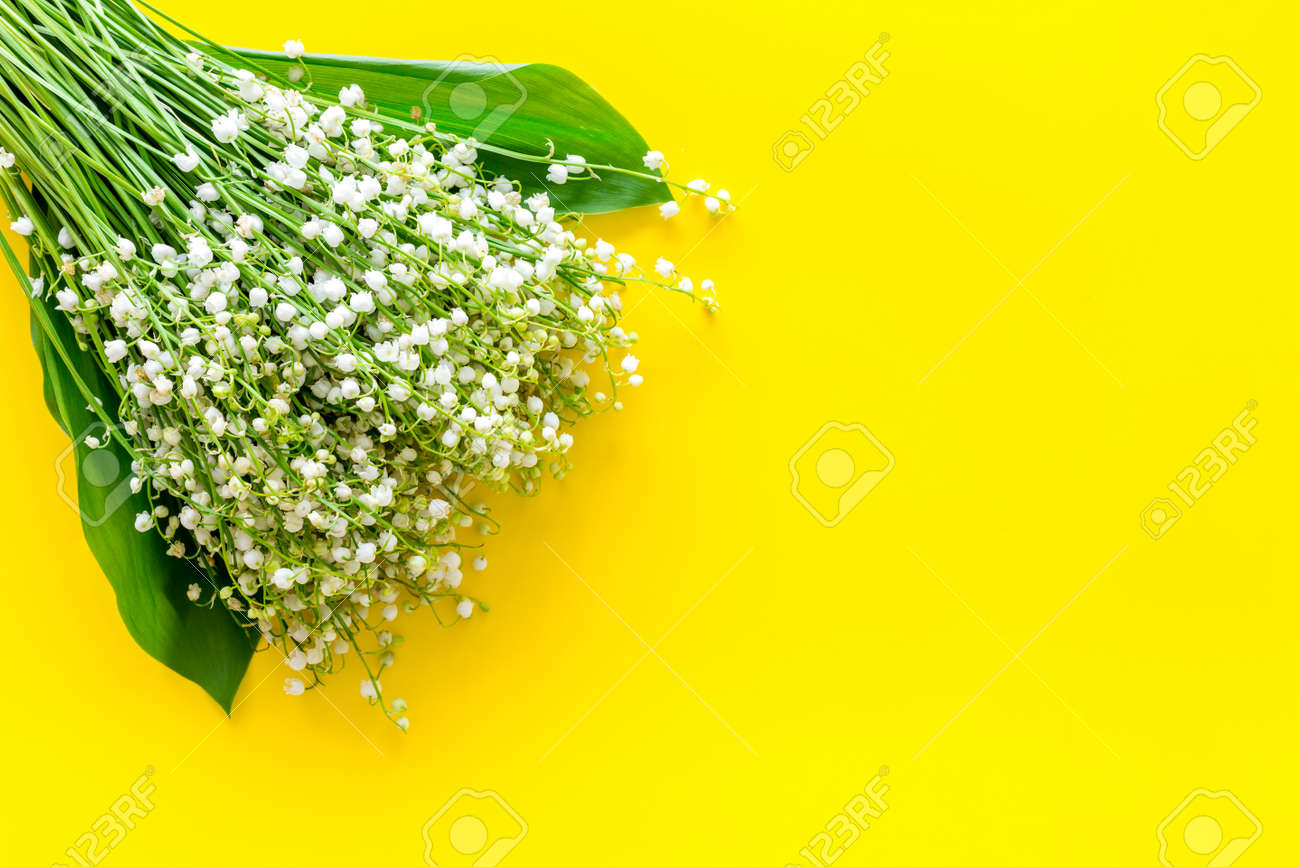 Small and fragrant spring flowers bouquet of lily of the valley small and fragrant spring flowers bouquet of lily of the valley flowers on yellow background mightylinksfo