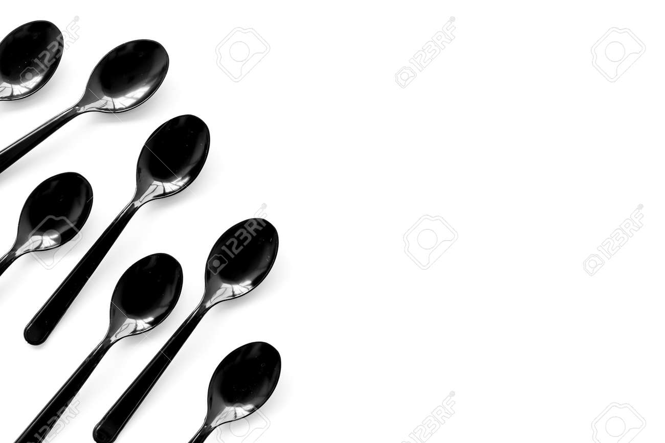 Plastic Flatware For Eco Concept On White Background Top View