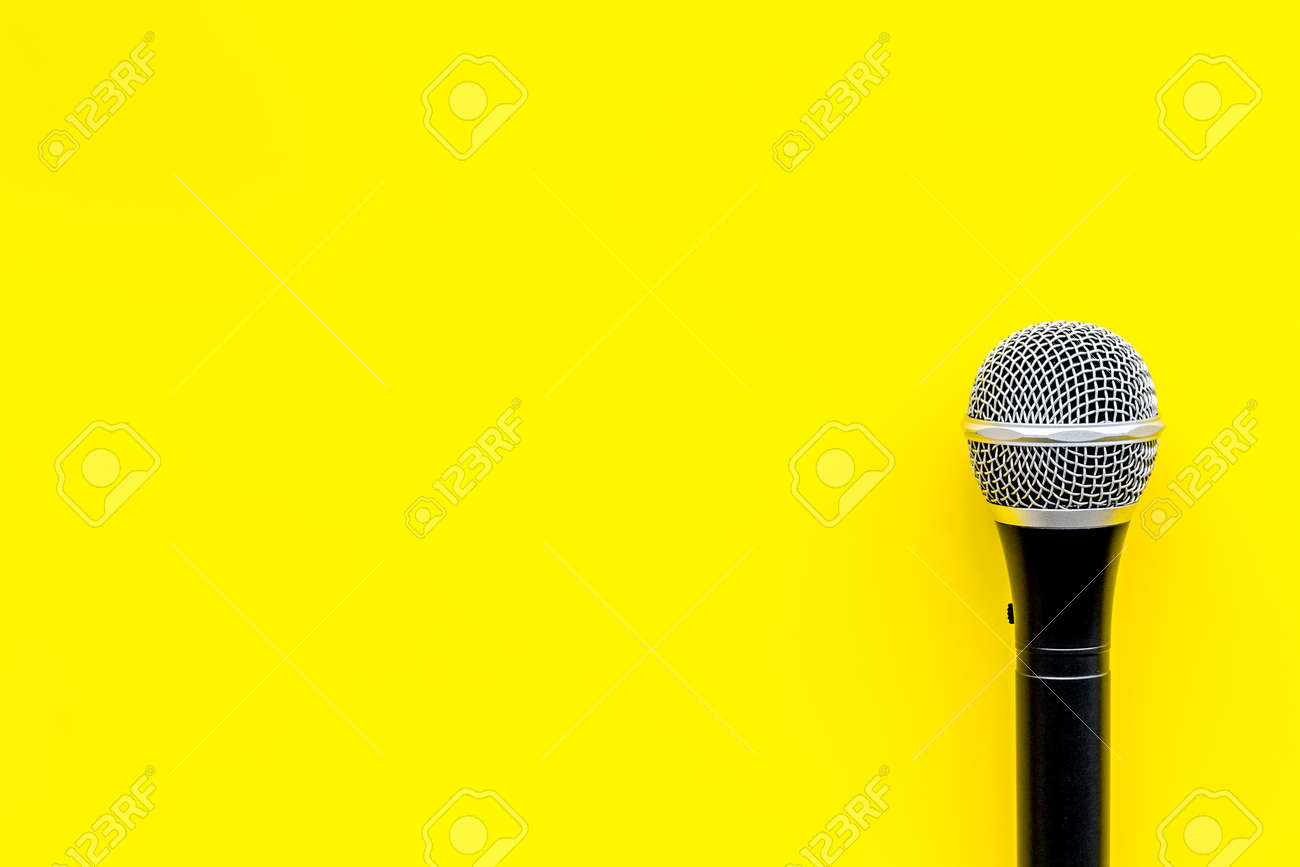 Podcast Record With Microphone On Yellow Office Desk Background Stock Photo Picture And Royalty Free Image Image 119568123