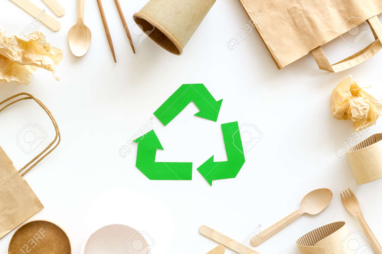 Recycling symbol and paper garbage on white background top view - 125127453
