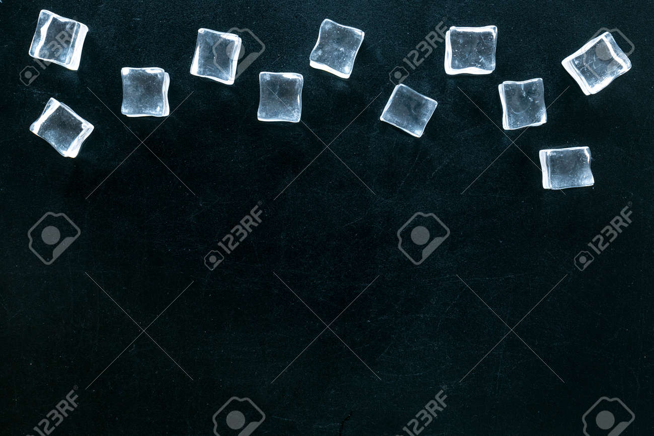 ice cubes on black table top view mock up - 128106971