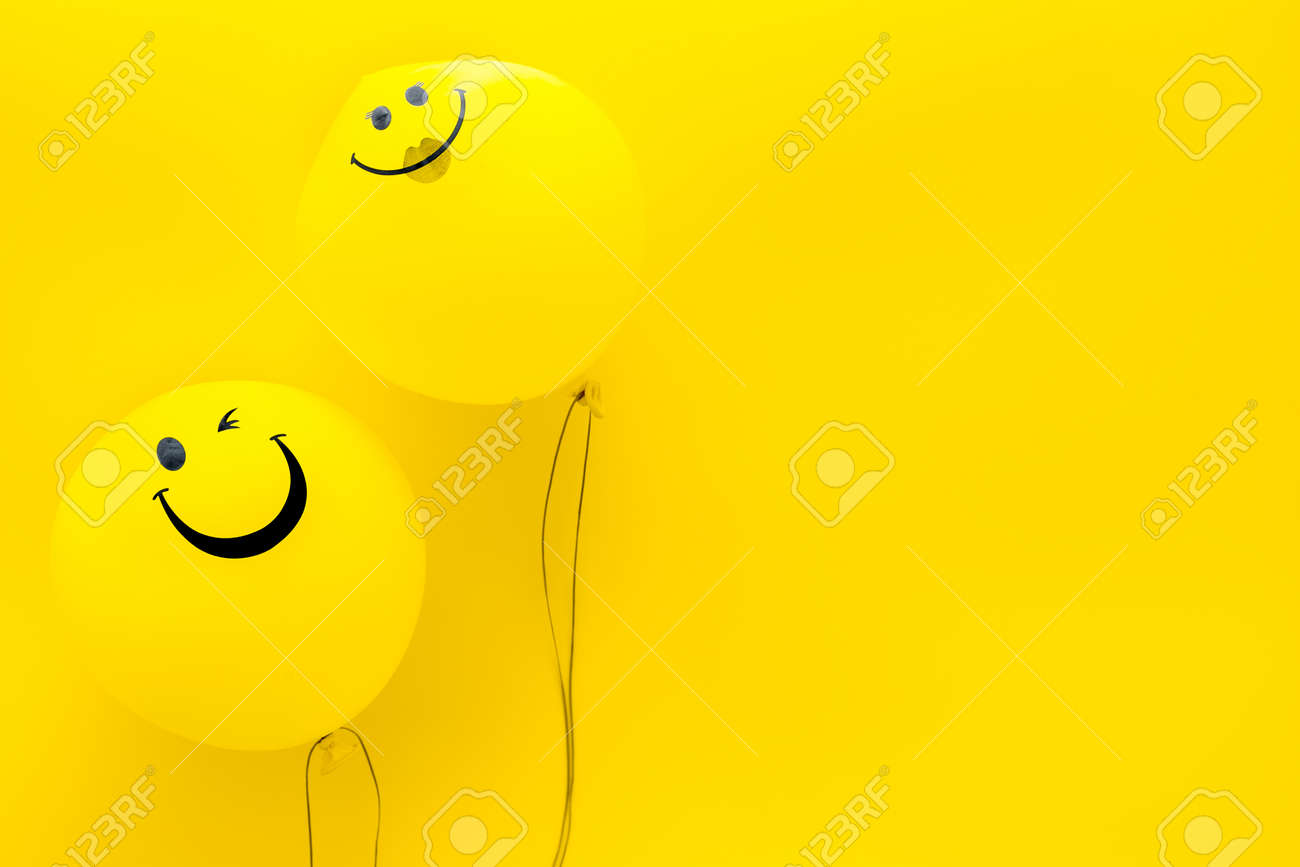 Happiness Emotion Yellow Balloon With Smile On Yellow Background Stock Photo Picture And Royalty Free Image Image 130560090