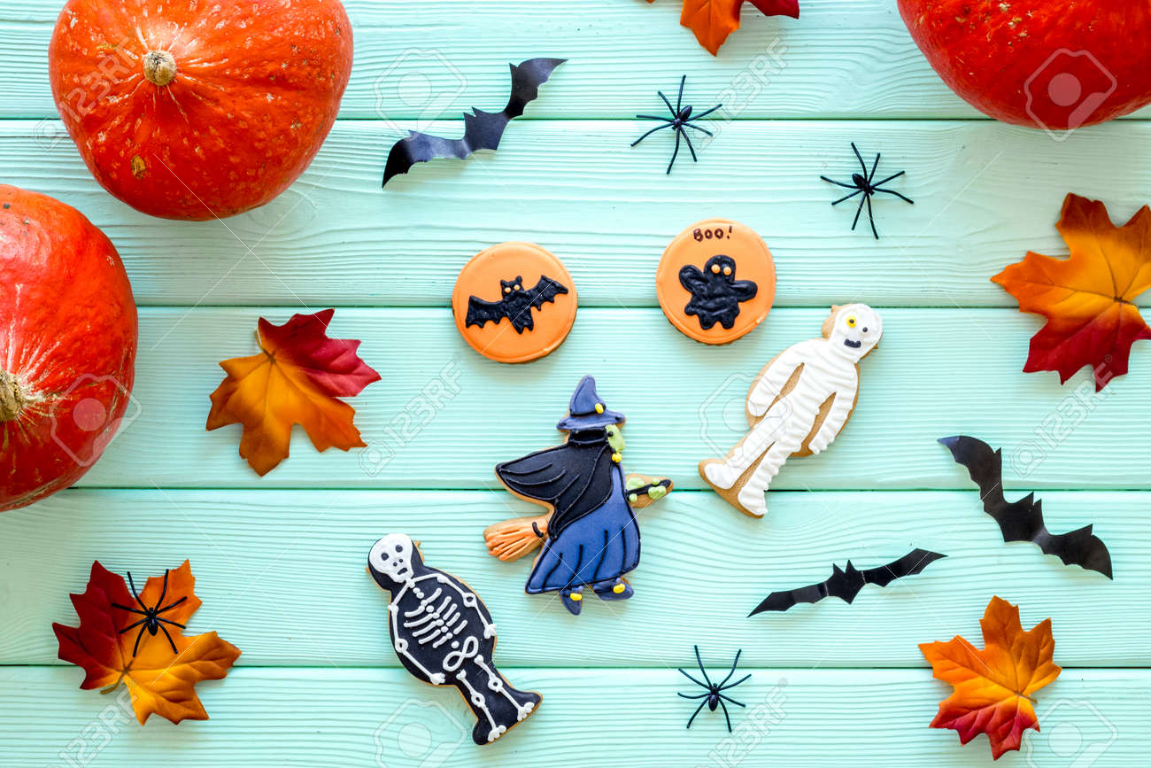 Halloween Background With Pumpkins Paper Bats And Special Cookies