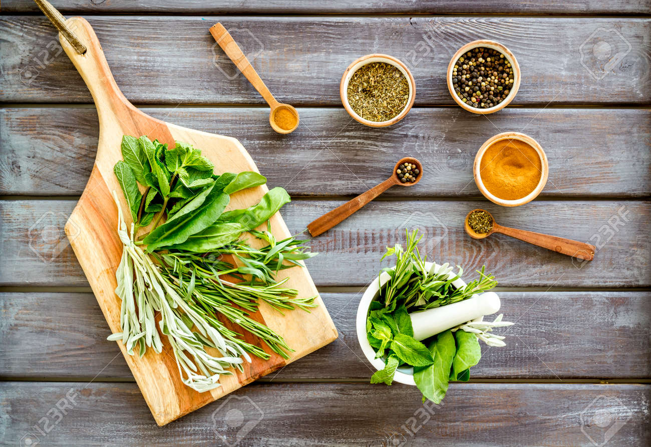 Herbs And Spices On Dark Wooden Kitchen Desk Top Down Stock Photo Picture And Royalty Free Image Image 140359649