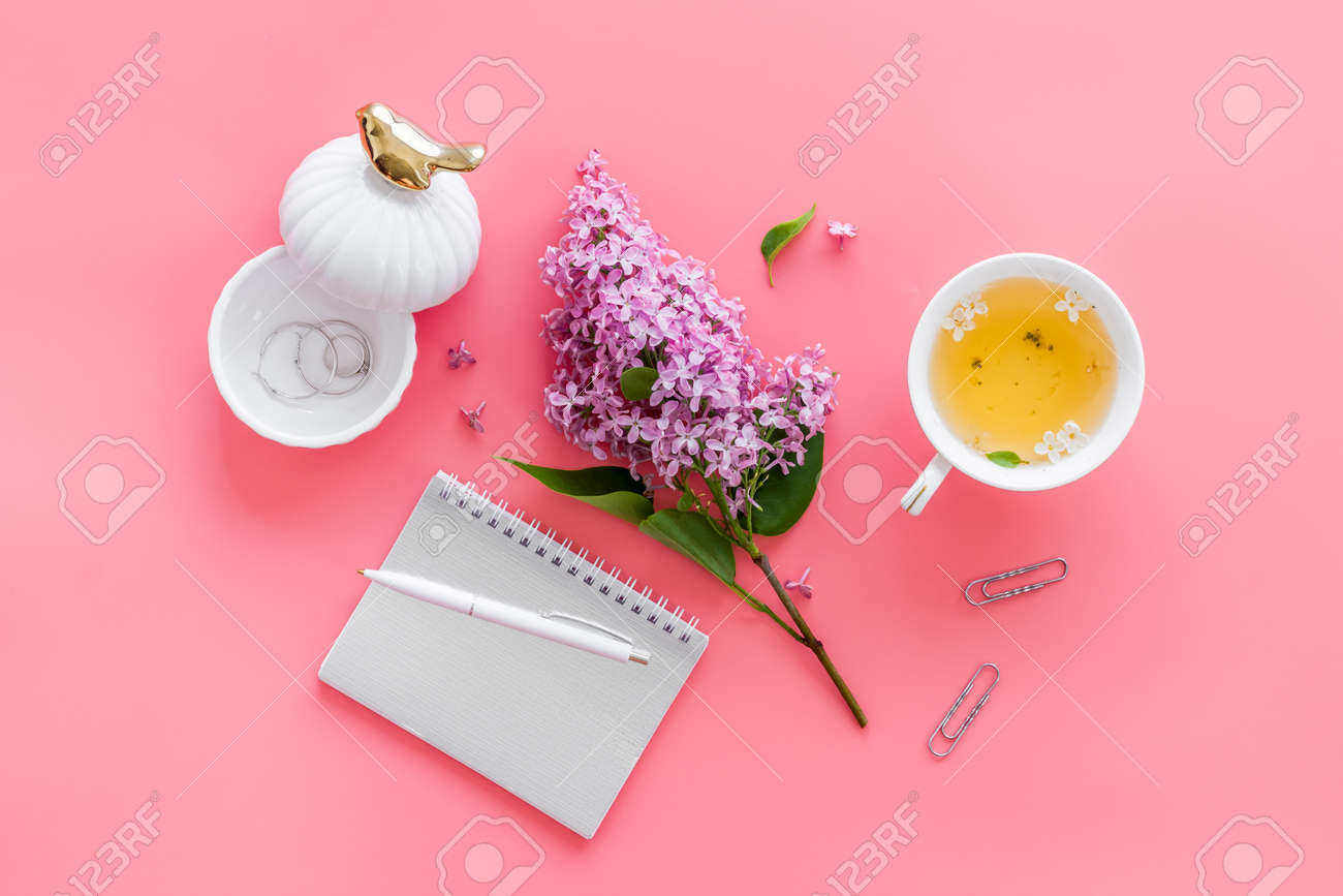 Lilas flowers bouquet with cup tea and notepad top view - 152899576