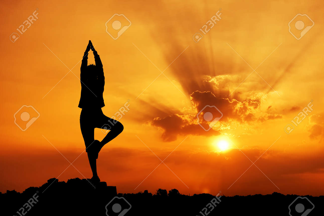 Silhouette of a beautiful Yoga woman in the morning - 9166574