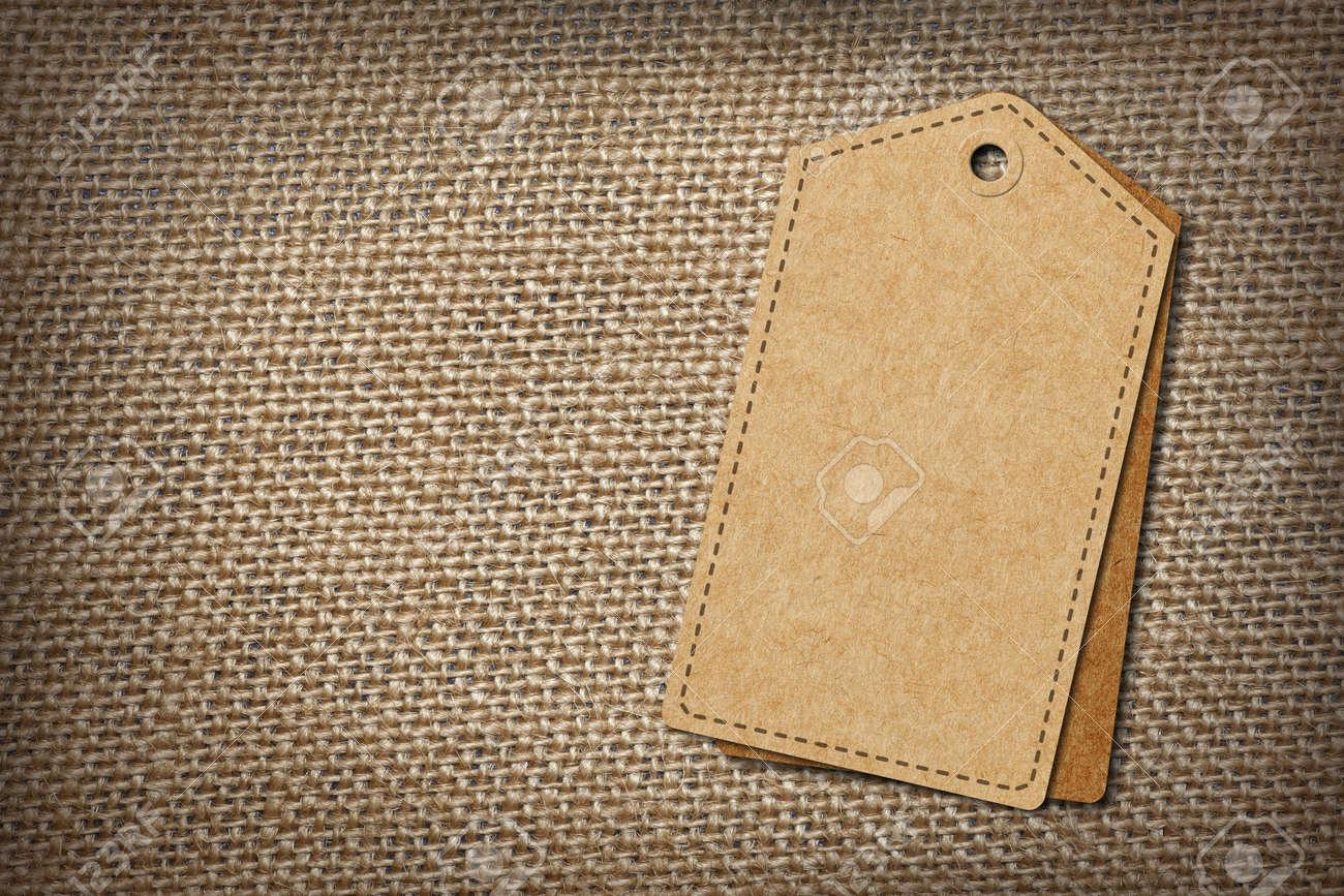 I tag background image - Stock Photo Background Of Burlap Hessian Sacking With Blank Paper Tag