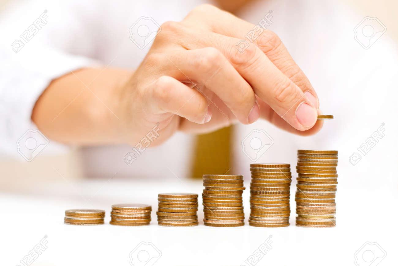a man rising coins - 12967899