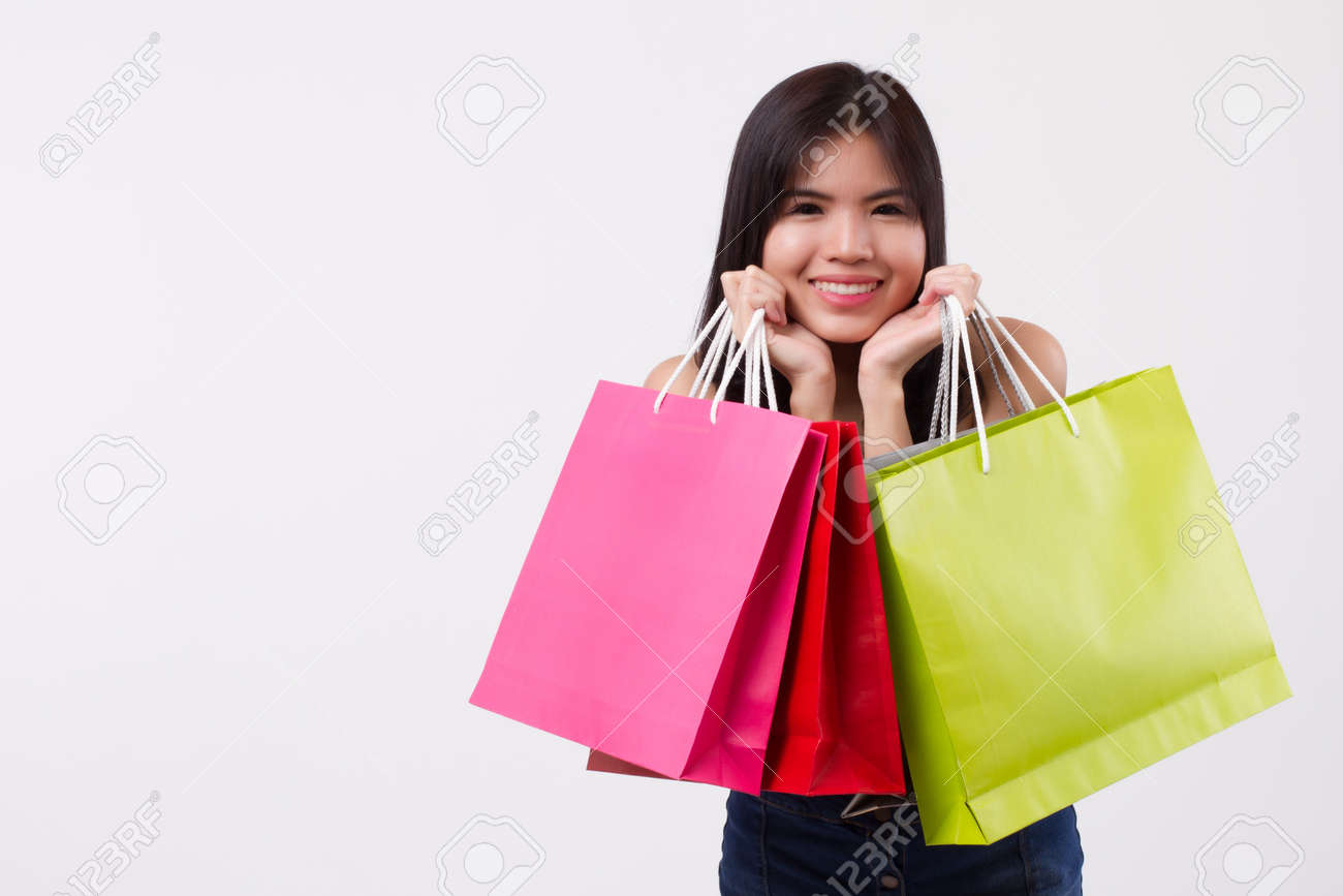 60870bf16d543 Happy smiling girl shopping, excited woman holding shopping bag isolated,  smiling girl happy woman
