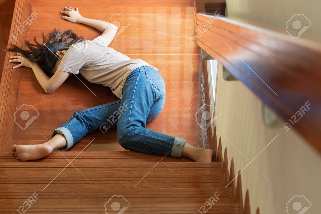 unconscious woman falling down from staircase - 130473246