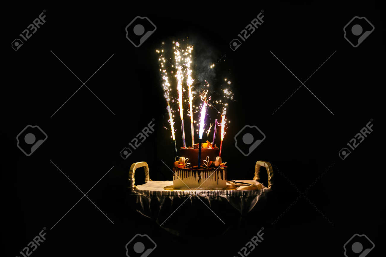 Enjoyable Birthday Cake With Fireworks On Table In Black Background Stock Funny Birthday Cards Online Alyptdamsfinfo