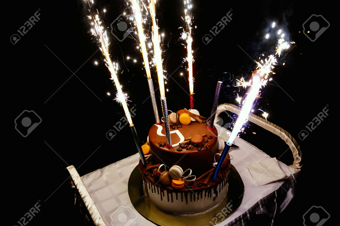 Astounding Birthday Cake With Fireworks On Table In Black Background Stock Funny Birthday Cards Online Alyptdamsfinfo