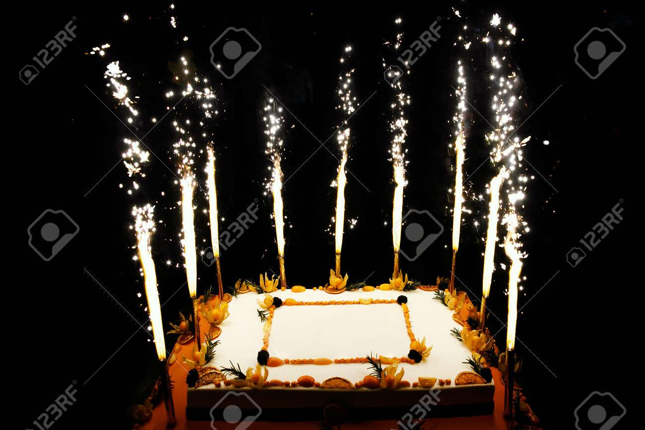 Rectangular Birthday Fruit Cake With Fireworks Candles Stock Photo