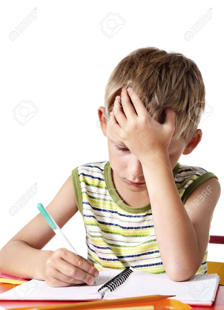 Schoolboy doing homework Stock Photo - 7782559