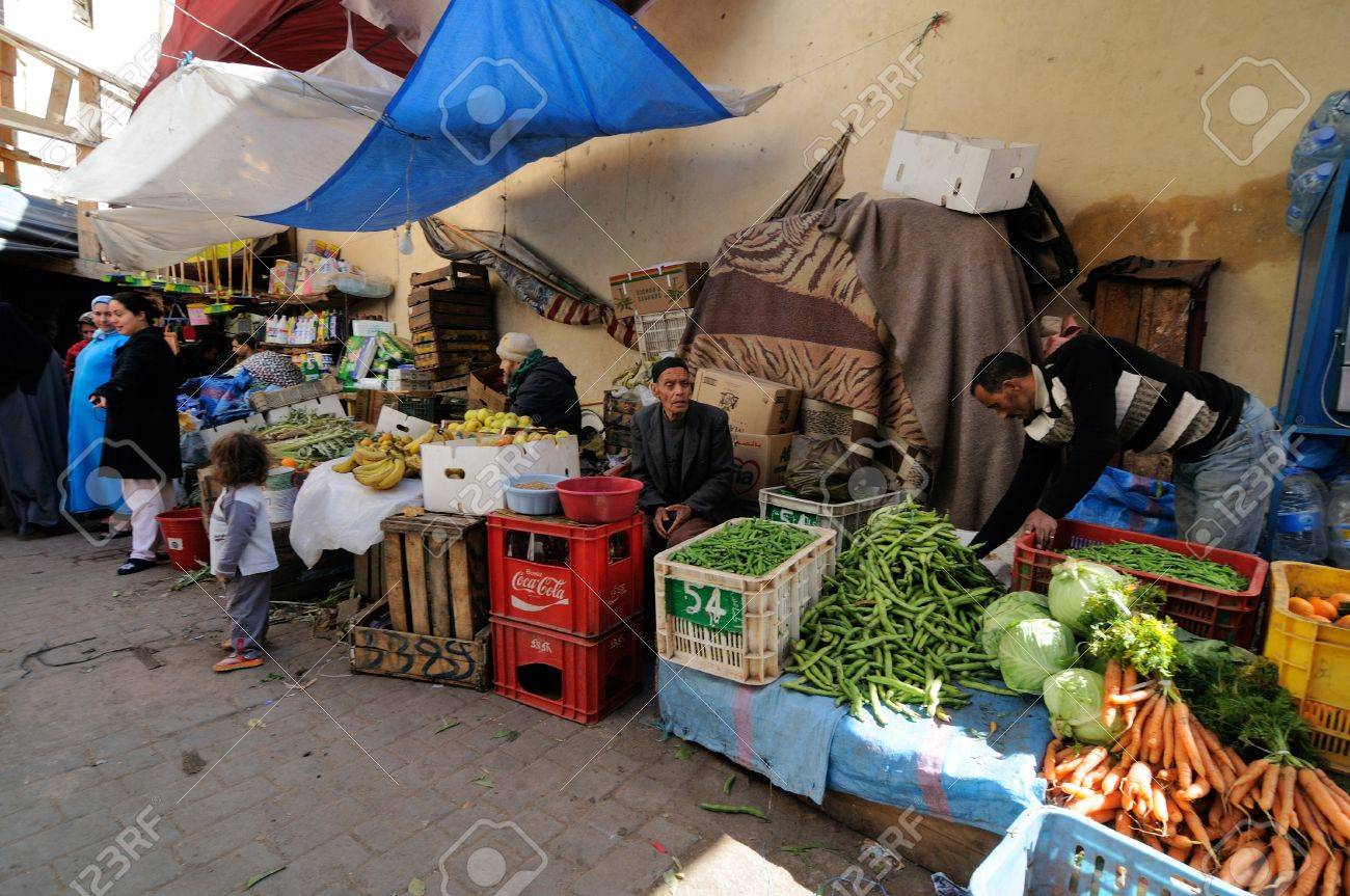 FES - MARCH 10: Unknown man trades a vegetables in a Market (souk) in a city Fes in Morocco. The market is one of the most important attractions of the city. March 10, 2012 Fes, Morocco. Stock Photo - 16532396