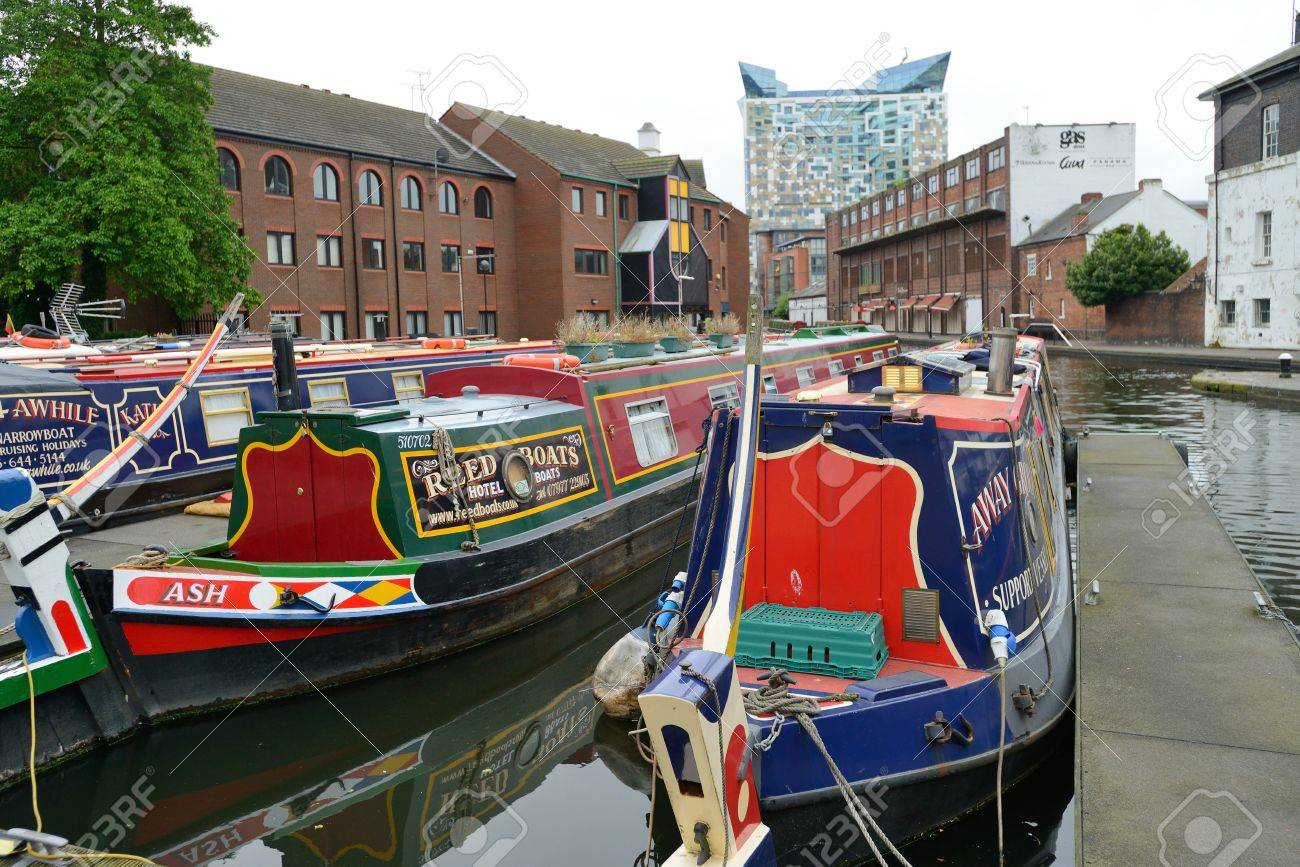 BIRMINGHAM, ENGLAND - JUNE 12  Colorful narrow boat, typical houseboats in West Midlands, England on June 12, 2013  Birmingham Canal is popular for leisure and has a number of narrow boat hire centers Stock Photo - 21242664