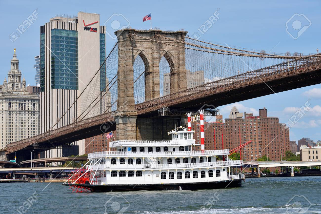 24bf580f NEW YORK CITY - AUG. 27: boat under Brooklyn Bridge on August 27, 2017 in New  York City, NY. The Brooklyn Bridge is one of the oldest bridges in the  United ...