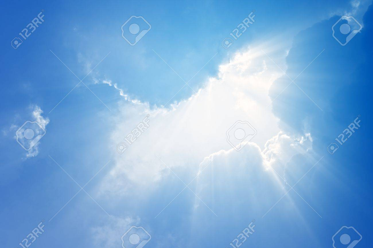 Perfect peaceful view - blue sky, white clouds, bright sun, bright beams. Stock Photo - 9773655