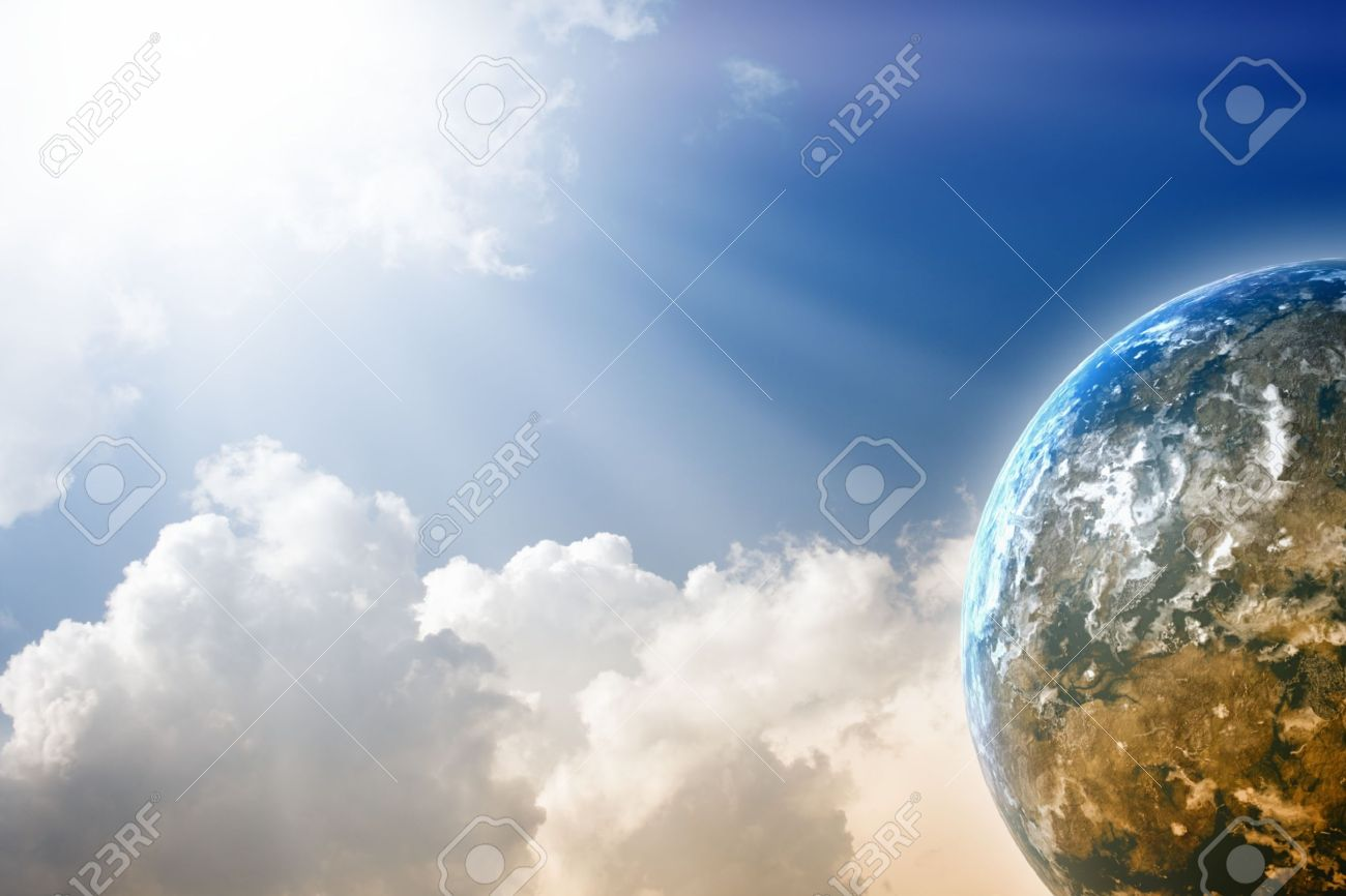 Peaceful background - planet  in blue sky, bright sun, white clouds Stock Photo - 11840156