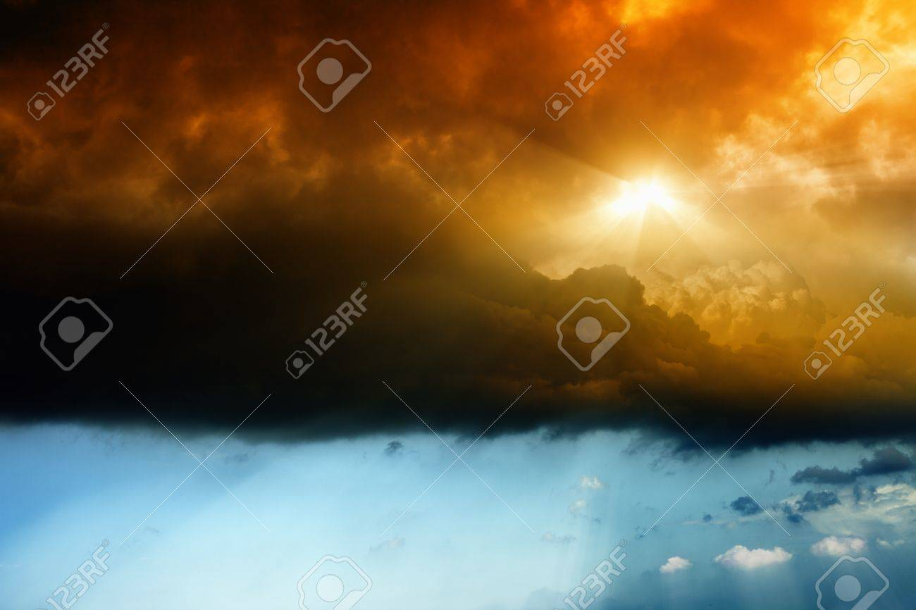 Dark dramatic sky with bright red sun Stock Photo - 13966551