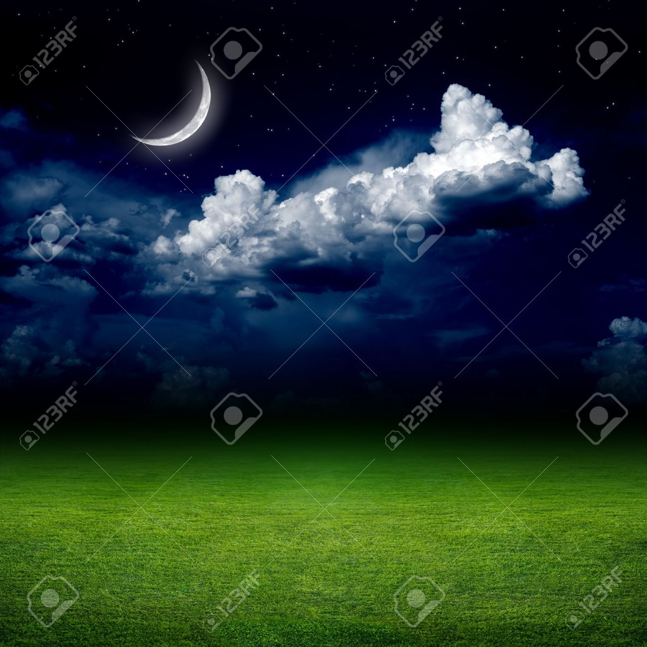 grass field at night. Night View Of Green Grass Field. Dark Sky With White Clouds, Moon And Stars Field At S