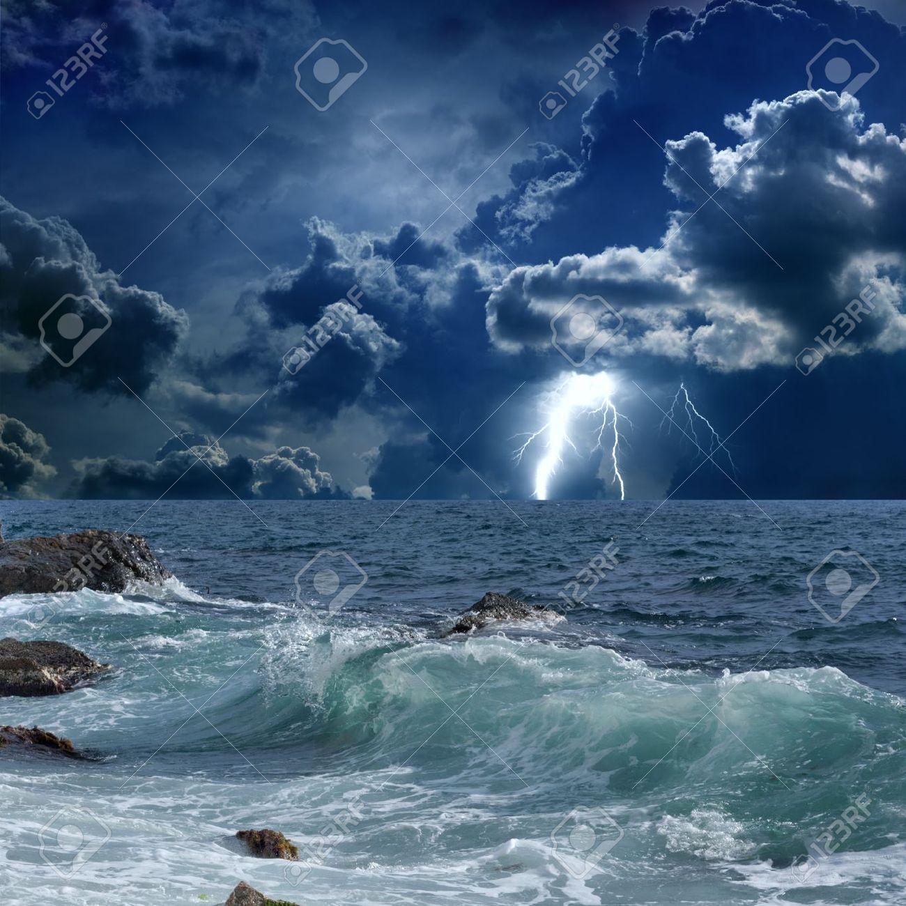 Dramatic nature background - lightnings in dark sky, stormy sea Stock Photo - 18983181