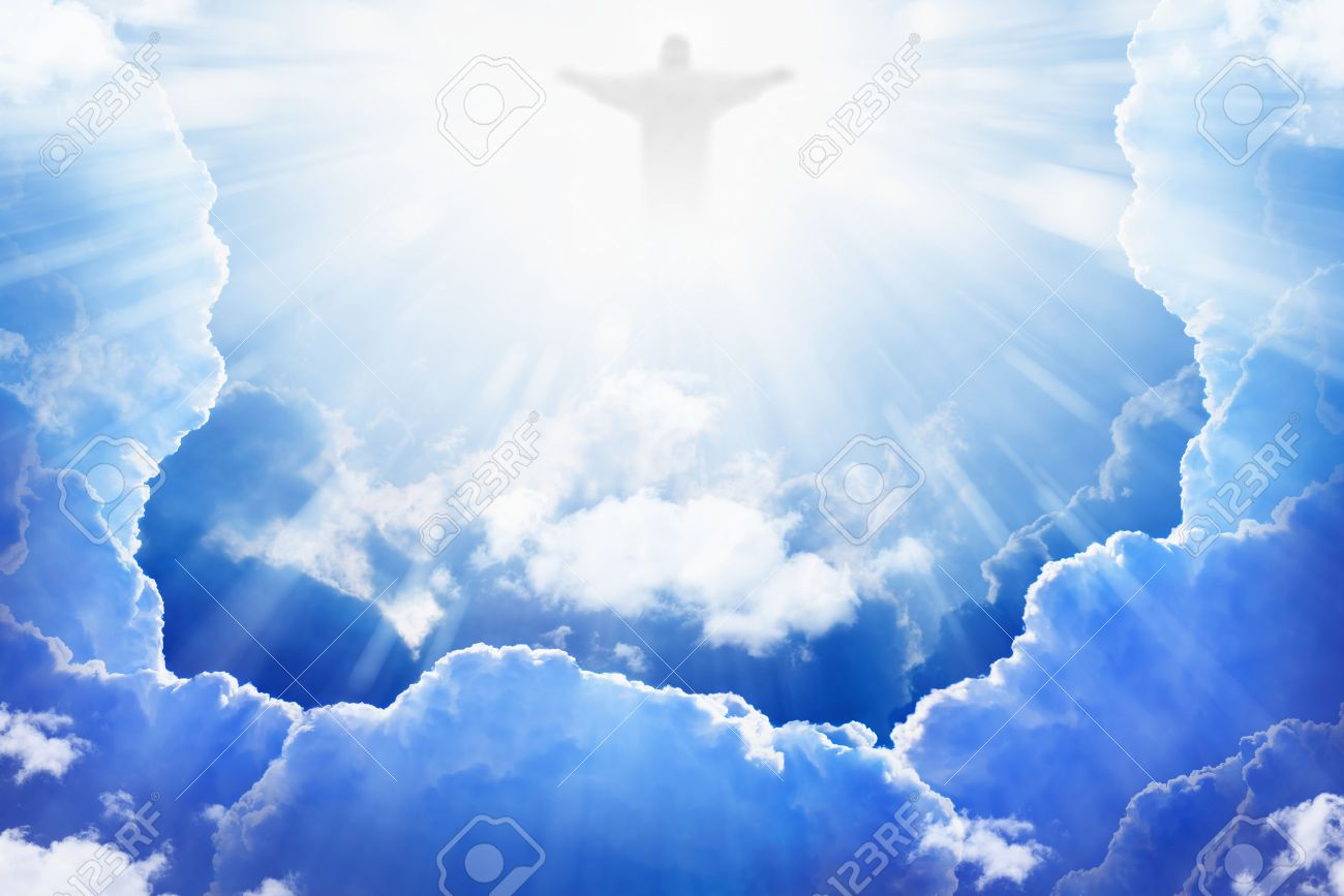 jesus christ in blue sky with clouds bright light from heaven
